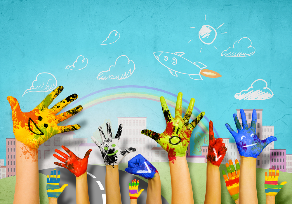 Pinwheel healthy kids phone supports students pictured are multiple hands in colored paint at a school with their hands up